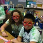 Amy celebrating 100 days of school with a student