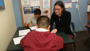 Samantha working with students.