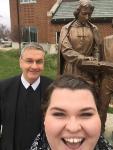 Molly and Brother Michael with a statue of the Founder